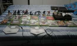 Xbox 360 with 13 games and 12 disney infinity figurenes