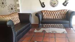 2 Over sized Black & Gold couches
