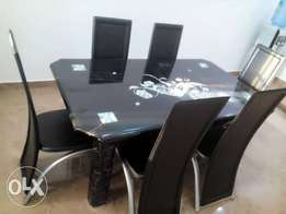 Exotic 6-Sitter Dining Table And Chairs