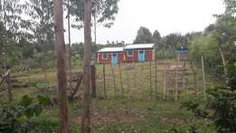 A plot with a house in it.2 doors 2 bedroom. With power and water