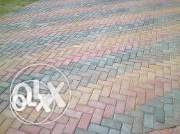 tar surfaces and brick paving