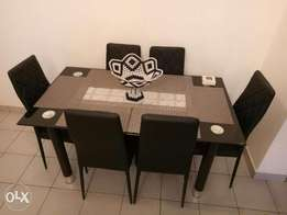 6 sitter dining table with leather sits