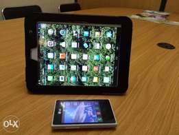 Tablet with a complimentary phone, both in perfect condition.