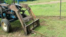 Rovic front end loader with bucket and bale fork attachment