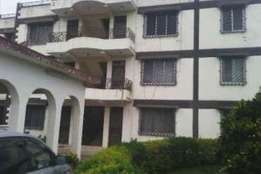 Entire 3 floor apartment building with 6 and 5 bedroom house for sale
