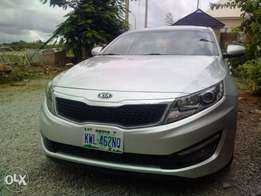Almost new 2012 Optima Kia is available for take away price in Abuja.