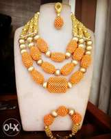 Coral orange beads with gold accessories