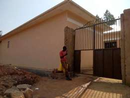Plot built with 9rental units namagoma with a land title available