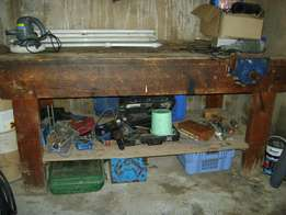 solid wooden work bench with vice