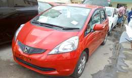 Wine red Honda fit KCL 2010