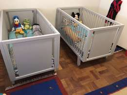 Twin baby cots and compactum