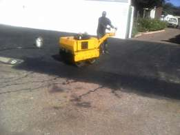 Tar surfacing , resurfacing , pothole patching , driveways , parking b