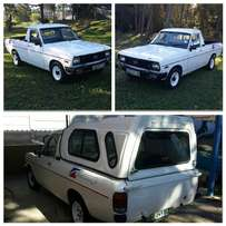 Reliable Nissan 1400 bakkie with canopy for sale