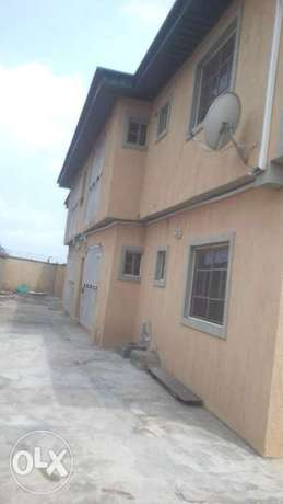 Neat and decent 2bedroom flat up with 3toilets at Igando close to b/s Igando - image 1