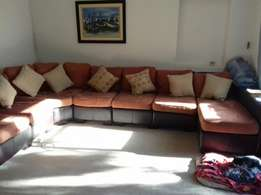 Seven seater couch with cushions