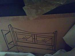 Wooden Tv Stand for Sale. Needs assembling and Screws misplaced.