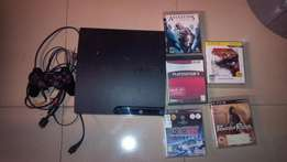 PS3 slim 40GB with 5 free blu ray game discs and 1 dual shock 2 pad