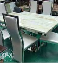 Cream marble dining table with six sitters