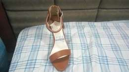 Very affordable high heeled new sandals for that chic and classy lady