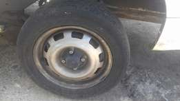 A set of chev rims a nd tyres for sale still in good condition