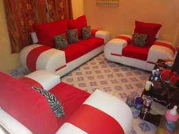 Sofa five seater with two puffs made of leather nd sued