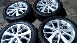 Set of Toyota 16 inches mag Rims with continental Tyres for sell