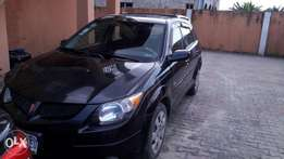 Clean tokunbo pontiac vibe 2004 model black colour with fabric seat.