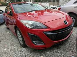 Mazda Axela red colour . 2010 model KCM number. Loaded with alloy rim