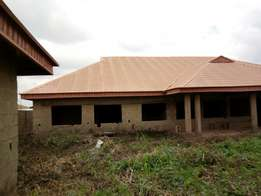 Fenced 6 bedroom near completion bungalow for sale on a 3 plots