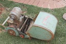 vintage rolux lawnmower with motor