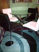 Glass top table and 4 chairs