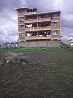 50*100 plot for apartments, ready title. 2nd from tarmac off Shooters.