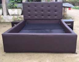 Buttoned Leather Upholstered 6ft By 6ft Bedframe.