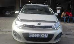 Kia Rio 2013 model 1.4 silver in color hatshback 76000km R132000
