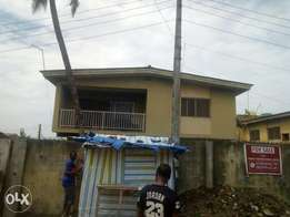 My house a story building along ojodu urgently for sale