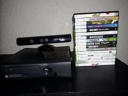 Xbox360 slim console, kinect and three controllers + 17 games.