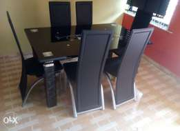 Quality six seater glass dining table