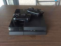 PlayStation4 with two controller in good condition and 1yr guarantee.