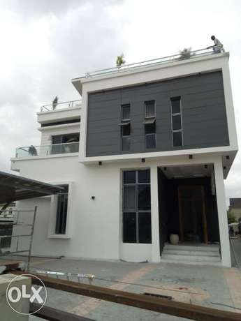 mansion with a swimming pool for sale in Osapa London Lekki - image 2
