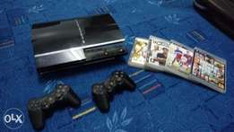 Sony ps3 quick sale 80gb, 2 pads and 5 games including GTA 5