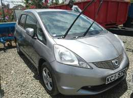 KCJ Honda Fit,2009 Models,1500 cc,Grey in Colour and Fully Loaded