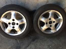 two rims needs tires 114 pcd 14s fit mazda ford or nissan
