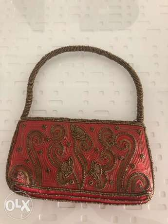 indian style red purse with gold sequins