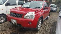 Extreamly  clean red Nissan X-Trail (2009) up to 90 % finance from cfc stanbic bank.