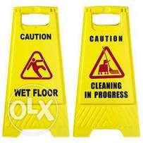 Wet floor, men at work and cleaning in progress caution signs