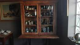 Yellow wood TOD trophy cabinet on industrial singerstand