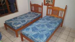 Varnished Pine single beds with mattresses
