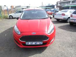 Finance available for 2015 Ford Fiesta,red in color ,4 doors,23 000 km