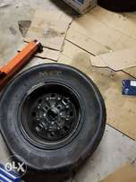 Full slicks for sale with steel rims. Never been used in a race as yet