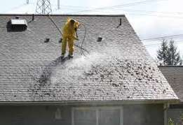 High pressure roof cleaning and painting